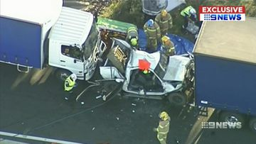 Couple lucky to be alive after becoming trapped between trucks