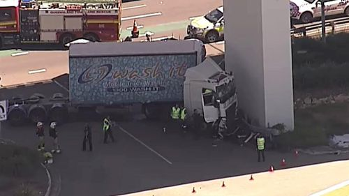 The truck came to a stop when it hit a guard rail in front of a support pillar. (Image: 9NEWS)