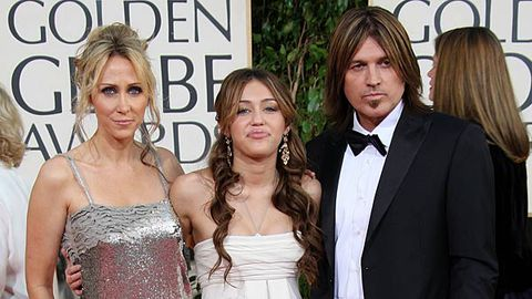 Miley with parents Billy Ray and Tish Cyrus