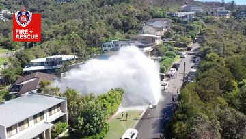 The burst main sent water gushing into the air.