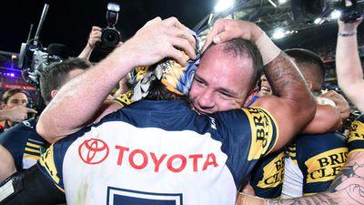 An emotional embrace between Cowboys' co-captains Matt Scott and Johnathan Thurston. (AAP)