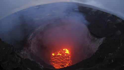 This photo from the US Geological Survey shows the lava lake at the summit near Pahoa. (AP)