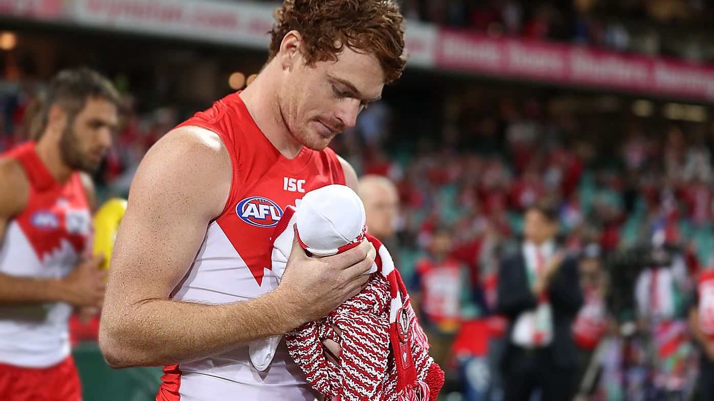 Sydney Swans star Gary Rohan walks out to game 100 with newborn baby Bella