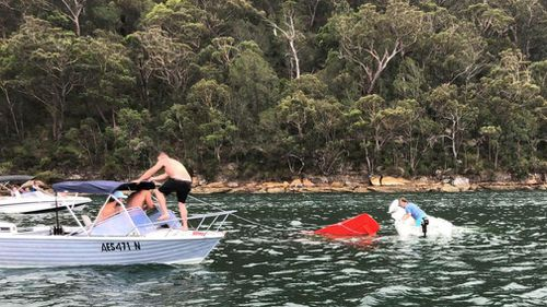 An attempt was made to try to tow the crashed plane to shore. (Supplied)