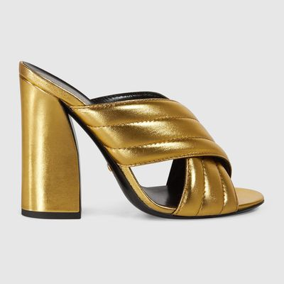 "<a href=""https://www.gucci.com/au/en_au/pr/women/womens-shoes/womens-sandals/metallic-crossover-sandal-p-408306B8B008016?position=16&amp;listName=ProductGridComponent&amp;categoryPath=Women/Womens-Shoes/Womens-Slides-Mules"" target=""_blank"">Gucci</a> Metallic Crossover sandal, $685<br>"