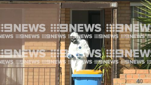 Police wore hazmat gear as they scoured the suspect's Shepparton home this morning.