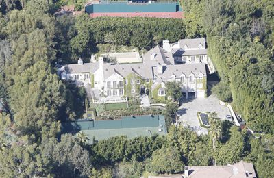 So <i>this</i> is where spoilt rotten celebrity kid,<B>Suri Cruise</b> spends her days. This aerial shot of <b>Tom Cruise</B> and <b>Katie Holmes</b>' mansion isn't bad, at least not for a five year old only child and her parents.  The house was originally built as a 10,000, yep, 10,000, square foot structure in 1937 but was <i>expanded</i> in 2003, four years before Tom and Katie snapped it up. The seven bedroom, nine bathroom home now sits on 1.3 acres behind tall gates and a long, long driveway. So how much did the place cost Katie and Tom? A whopping $35 million.