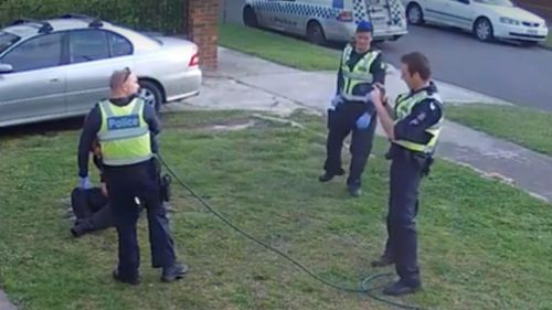 One of the officers is shown filming the incident as it unfolds. (Fairfax Media)