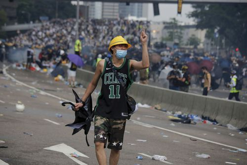 A protester gestures after clashes with riot police during a massive demonstration outside the Legislative Council in Hong Kong.