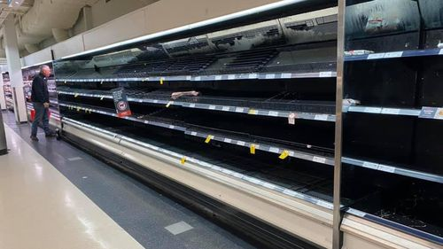 North Richmond supermarket shelves stripped bare as the community is cut off by floodwaters.