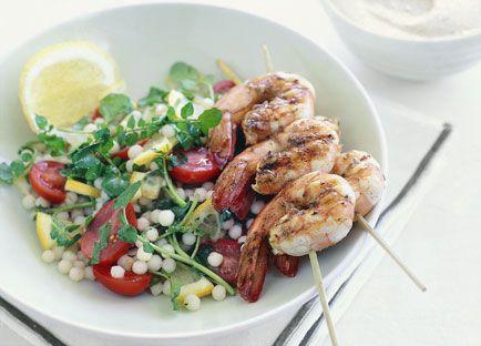 Warm moghrabieh salad with barbecued prawn brochettes and almond tarator