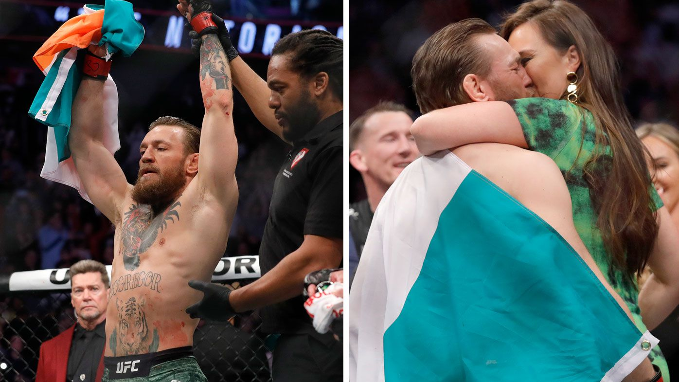 Conor McGregor kisses Dee Devlin after his first round TKO victory against Donald Cerrone