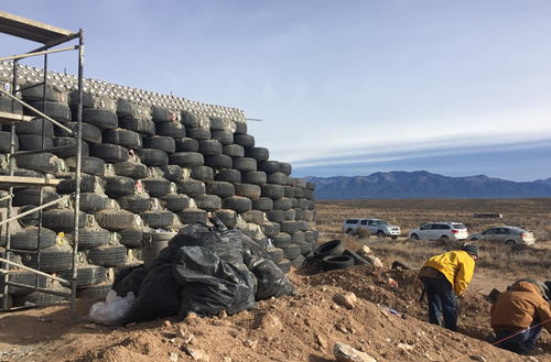 Earthship walls are made from tyres and soft drink cans. (9NEWS)