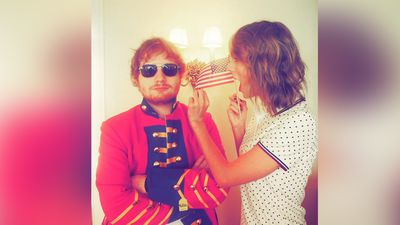 "<p>Taylor Swift held a Fourth of July party/sleepover with an all-star guest list, including Ed Sheeran.</p><p>Swift Shared this shot of her and Ed with the playful caption ""When @edsheeran shows up for the 4th of July in a red coat because he just can't let it go.""</p><p>Sheeran soon replied, ""I don't even know what you're celebrating I just turned up for the free booze"".(Instagram)</p>"