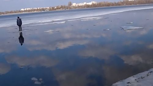 The boy was floating on a thin sheet of ice in Kyiv.