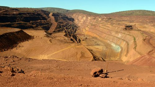 The price of iron ore has plunged from $120 a tonne 12 months ago to $63 tonne a tonne. (AAP)