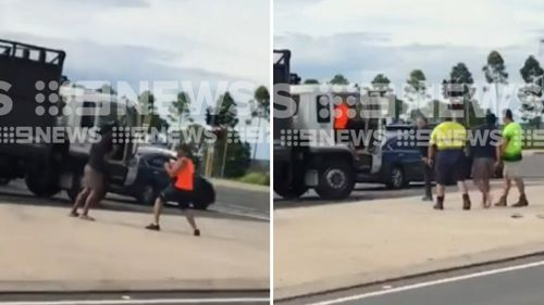 The two men can be seen brawling in mobile phone footage obtained by 9News.