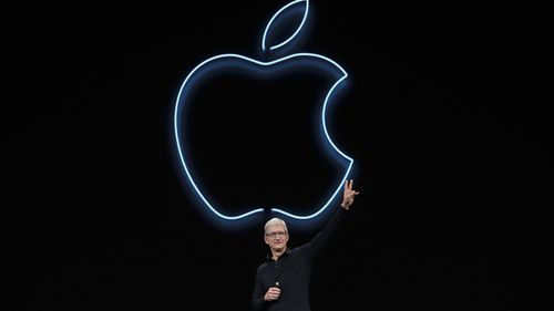 Apple CEO Tim Cook waves after speaking at the Apple Worldwide Developers Conference in San Jose, Calif., Monday, June 3, 2019.