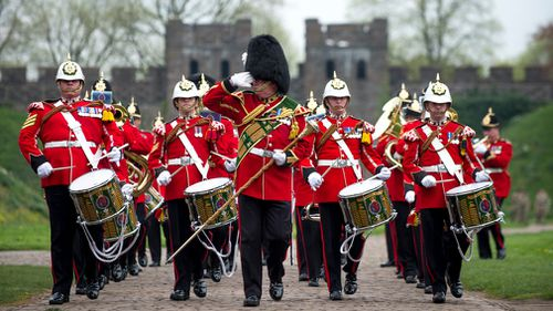 The Band and Corps of Drums of The Royal Welsh march inside the grounds of Cardiff Castle, Wales, to celebrate Queen Elizabeth II's 92nd birthday. (AP)