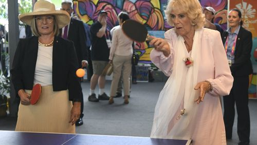 The Duchess and Ms Turnbull try their hand at table tennis. (AAP)