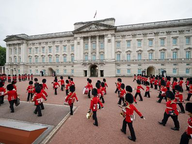 Members of the Nijmegen Company Grenadier Guards and the 1st Battalion the Coldstream Guards take part in the Changing of the Guard, in the forecourt of Buckingham Palace