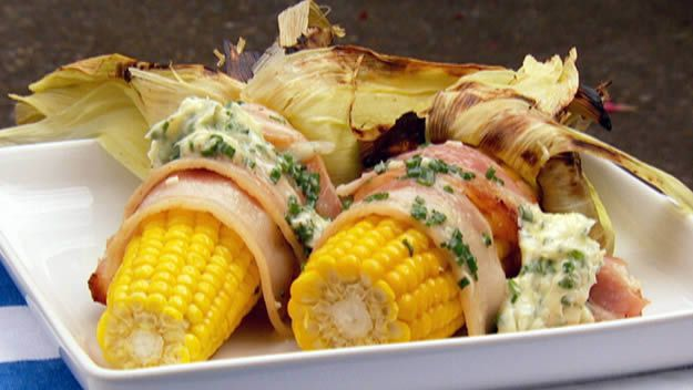 Bbq corn cobs with bacon and garlic butter