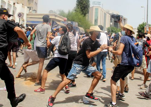 Thousands of people defied COVID-19 restrictions and heat to demonstrate in the capital of Tunis and other cities.