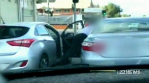 Horrified motorists watched on as the vicious brawl unfolded during this morning's peak-hour on West Terrace. (9NEWS)