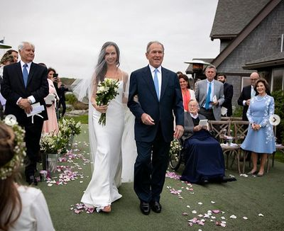 George W. Bush walks daughter Barbara Bush down the aisle on her wedding day, held at the Bush family compound in Kennebunkport, Maine, October 7, 2018.
