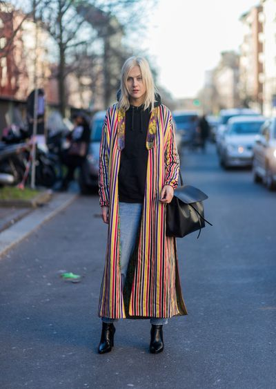 <p>Coats are long, bright and bold with smart, sexy accessories like this one worn by Linda Toll.</p> <p>Image: Getty.</p>