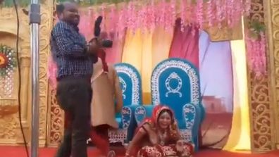 Bride's surprise response after groom strikes photographer during wedding