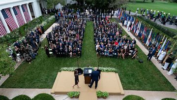 Judge Amy Coney Barrett walks to the microphone after President Donald Trump, right, announced Barrett as his nominee to the Supreme Court, in the Rose Garden at the White House, Saturday, Sept. 26, 2020, in Washington.
