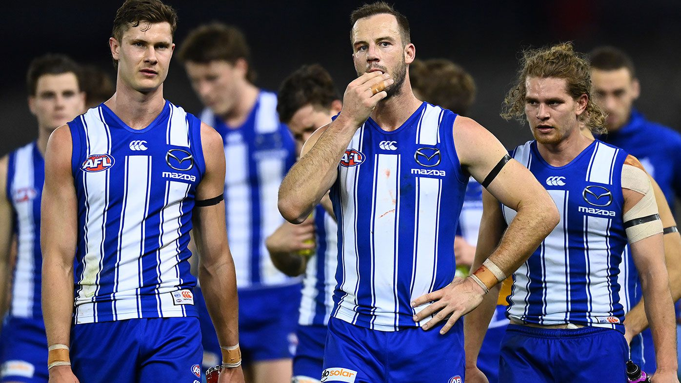 The Kangaroos look dejected after losing the round 22 AFL match between North Melbourne Kangaroos and Sydney Swans at Marvel Stadium on August 14, 2021 in Melbourne, Australia. (Photo by Quinn Rooney/Getty Images