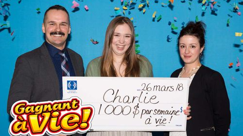 Charlie Lagarde (centre) celebrates her lottery win. (Loto Quebec)