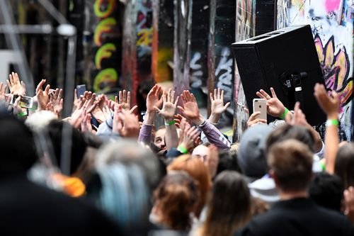 Selective fans gather for a performance of Ed Sheeran in Hosier Lane. (AAP)