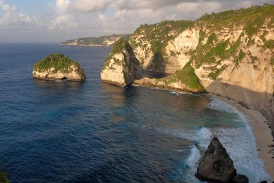 Atuh Beach<br /> This beach is perhaps one of the most striking areas you will comes across in Bali.<br /> Think shimmering turquoise waters with spectacular surrounding mountain peaks.<br /> It&rsquo;s suggested you visit this beach during the day so you can fully appreciate Atuh's beauty.&#160;<br /> Image/Getty