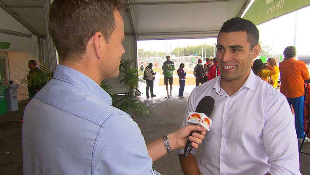 Pita Taufatofua talks to 9NEWS reporter Tom Steinfort. (TODAY)