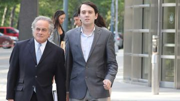 Martin Shkreli (right) and his lawyer Benjamin Brafman outside court. (AAP)
