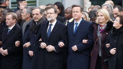 World leaders including (L-R) Irish Prime Minister Enda Kenny, NATO Secretary-General Jens Stoltenberg, Greek Prime Minister Antonis Samaras, Spanish Prime Minister Mariano Rajoy, British Prime Minister David Cameron, Danish Prime Minister Helle Thorning-Schmidt and Polish Prime Minister Ewa Kopacz walk at the start of a march to honor the victims of the terrorist attacks and to show unity. (AAP)