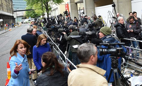 The media pack awaits news of the royal birth. (AAP)