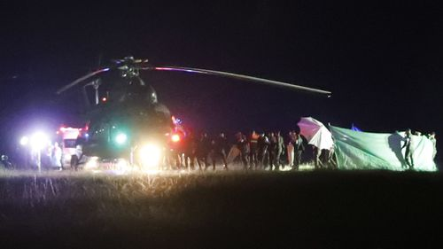 A helicopter takes one of the rescued boys to safety.