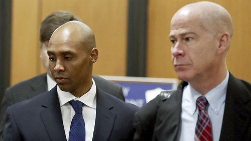 Former Minneapolis police officer Mohamed Noor, center, is accompanied by his attorneys Peter Wold, not pictured, and Thomas Plunkett, right, as he walks towards the Hennepin County Government Center for opening arguments of his trial.
