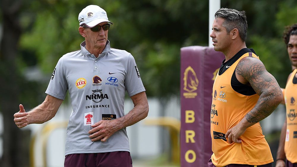 Wayne Bennett discusses tactics with his captain, Corey Parker. (AAP)