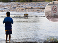 Floodwaters pose risk to homes in Queensland after unexpected rainfall