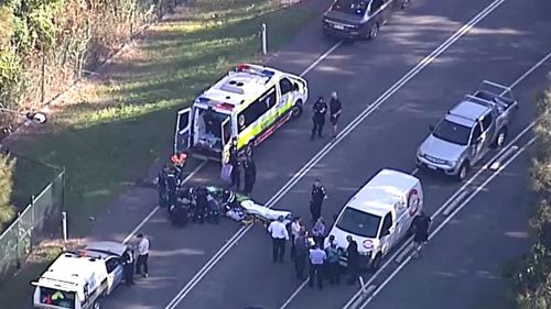 The man is assisted by paramedics. Picture: 9NEWS