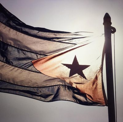 Chanel's first post about the presentation - the Cuban flag.