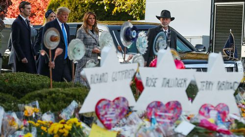 President Donald Trump (left) walks with Melania, Ivanka (centre) and son-in-law Jared Kushner, alongside Tree of Life Synagogue rabbi Jeffrey Myers, near the memorial site to the 11 victims in Pittsburgh.