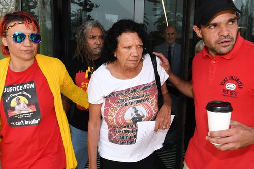 David Dungay's mother Leetona Dungay is led from the court by family and friends outside the Lidcombe Coroner's Court in Sydney.