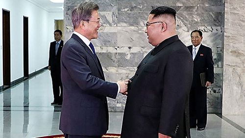 South Korea President Moon Jae-in (left) met with North Korean leader Kim Jong Un (right) in a surprise second summit on Saturday (Getty/Handout)
