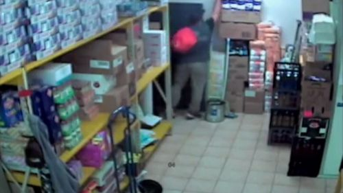 Security cameras were rolling when the thief broke in through the rear door of the Baldivis deli on November 29. (9NEWS)
